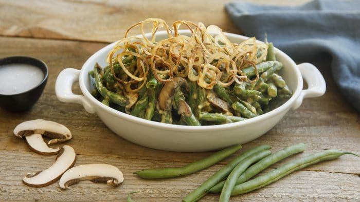 vegan green beans dish served on a ceramic casserole